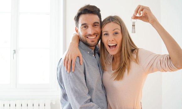 Happy couple holding a key