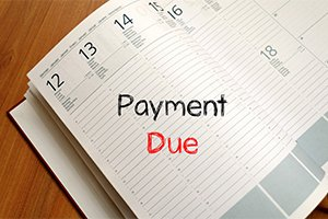 Payment due text concept on notebook